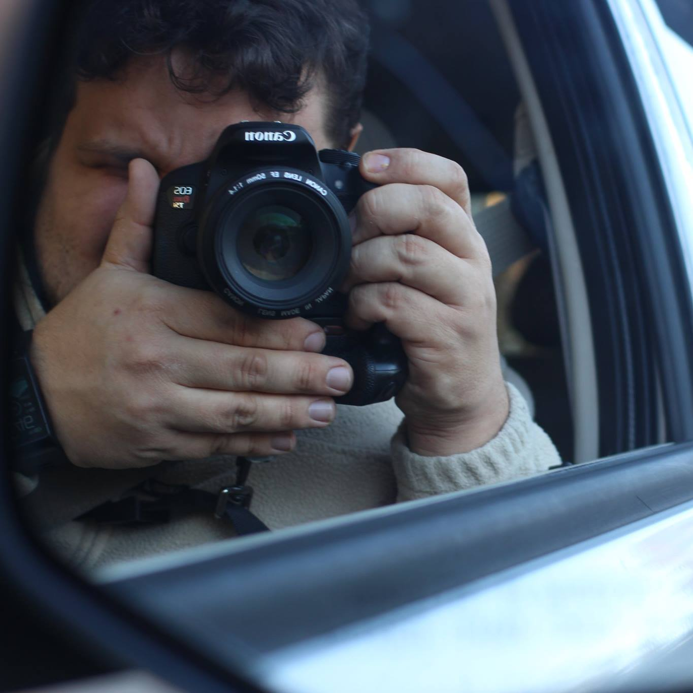 me taking a picture in a car mirrior